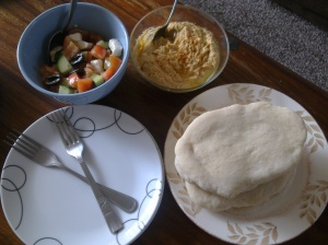 Pitta bread with houmous and Greek salad