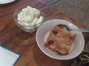 Warm plum cake and almond cream